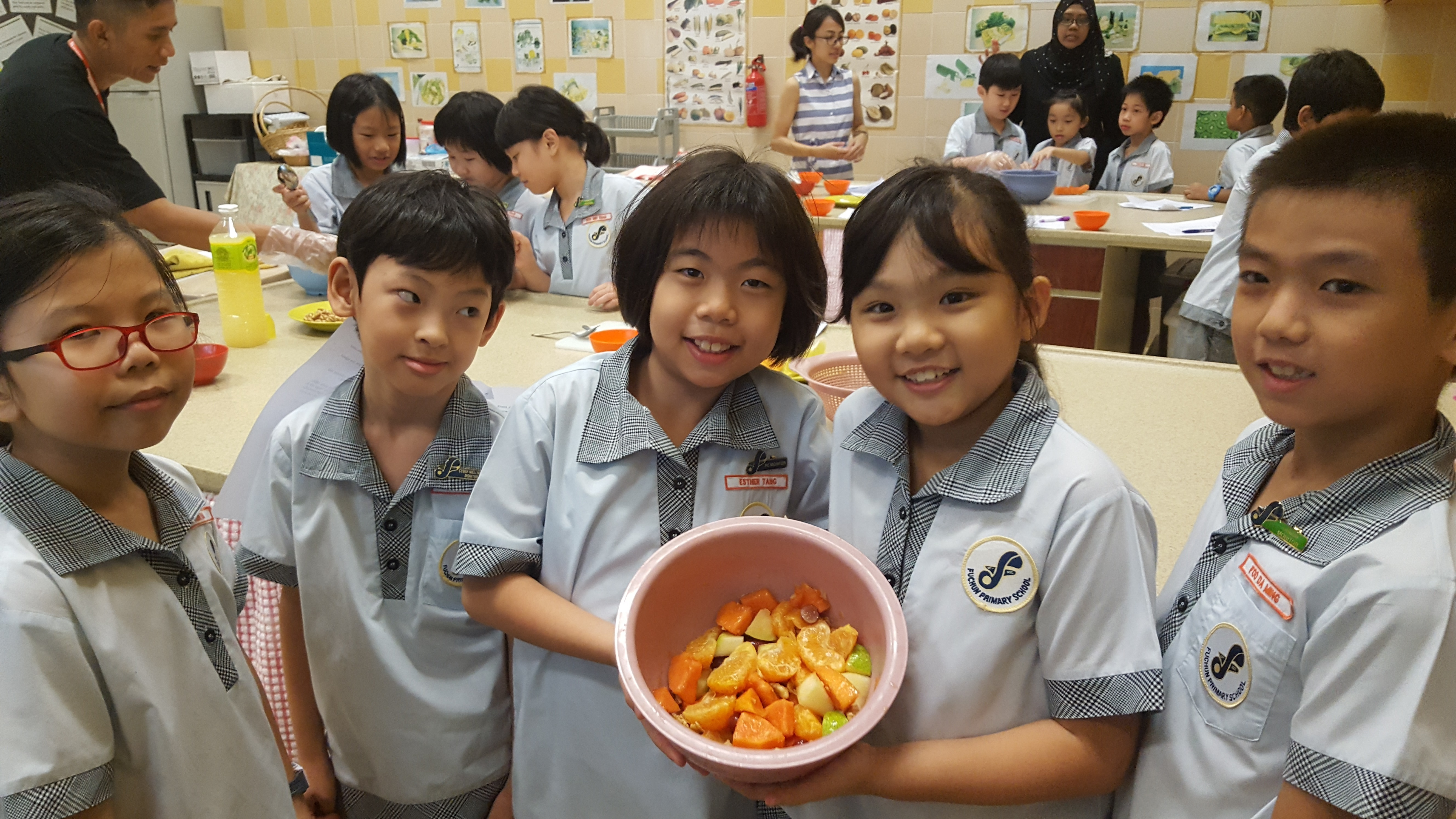 P3_Homeskills_Pupils proudly showing their furit salad.jpg