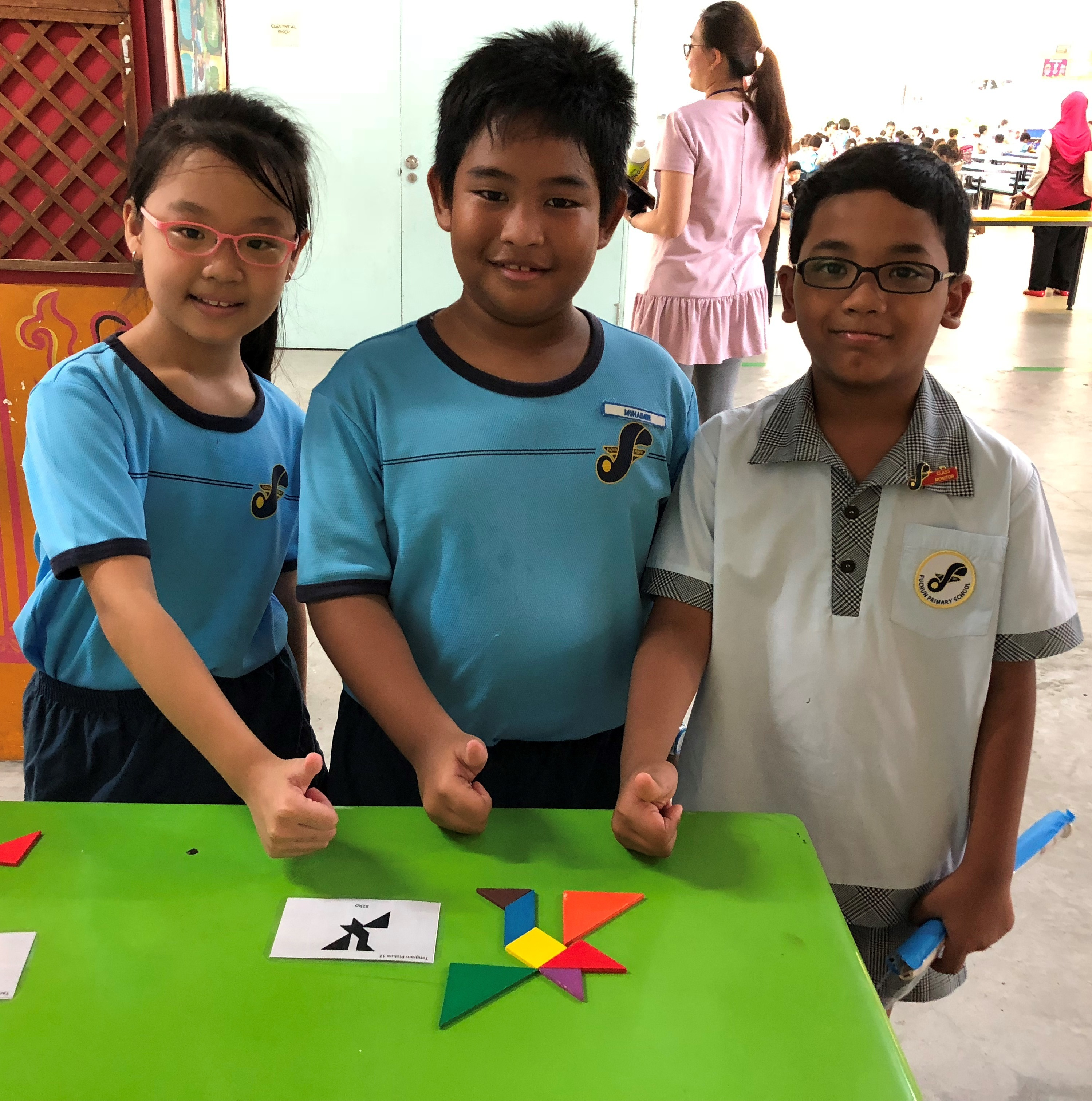 Thumbs up to a completed tangram puzzle.JPG